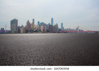 Empty road surface floor with modern city landmark buildings backgrounds in Chongqing Skyline