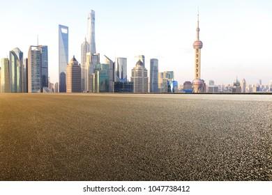Empty road surface floor with modern city landmark buildings backgrounds in Shanghai bund Skyline