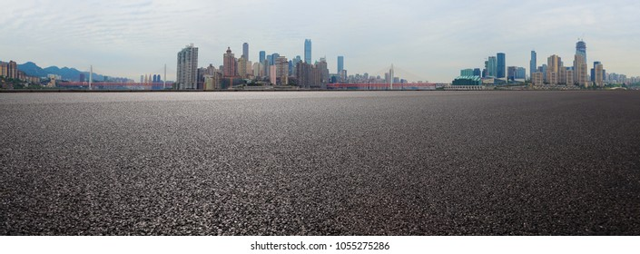 Empty road surface floor with modern city landmark buildings backgrounds in Chongqing panorama Skyline