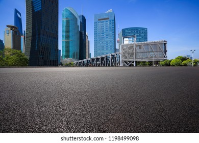 Empty road surface floor with modern city landmark buildings backgrounds in Shanghai