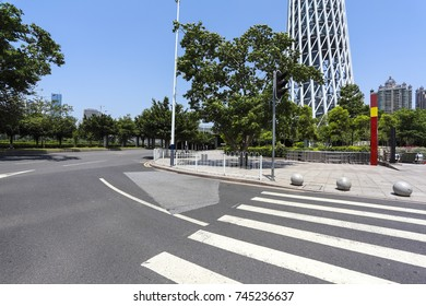 Empty road surface floor with modern city landmark architecture backgrounds in Guangzhou China