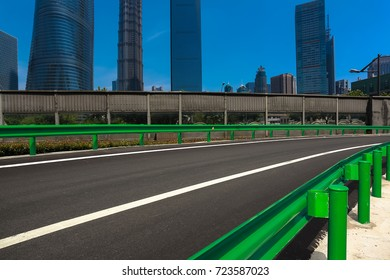 Empty road surface floor with shanghai lujiazui modern city landmark buildings backgrounds