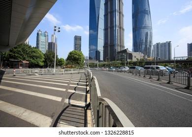 Empty road surface floor street with modern city landmark buildings backgrounds in Shanghai