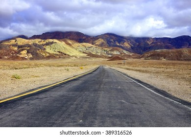 Empty road through the formations at Death Valley National Park, California