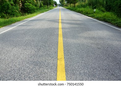 Empty road without car in morning.Yellow road dividers.