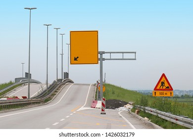 Empty road without traffic on highway with road works sign