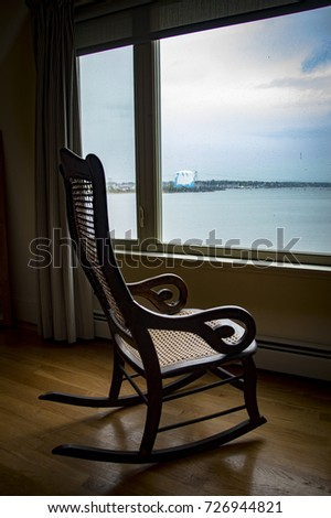 Empty Rocking Chair Looking At View Of Bay Through Window & Empty Rocking Chair Looking View Bay Stock Photo (Edit Now ...