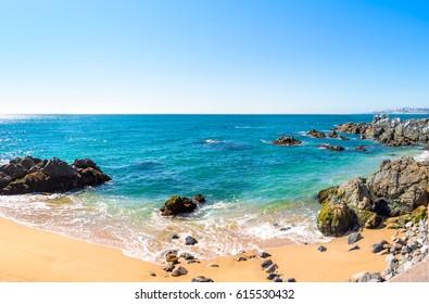 Empty rocky beach on sunny day