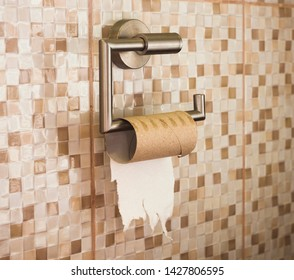 empty roll of toilet paper in the bathroom. the end concept