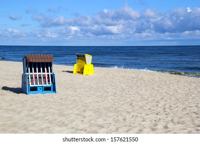 Empty roofed wicker beach chairs at the Usedom beach
