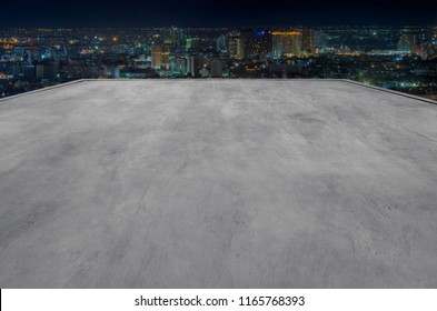 Empty rooftop of the building is perfect for showcase with modern cityscape background.