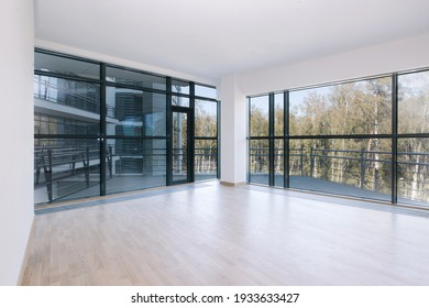 Empty room with big window in loft style