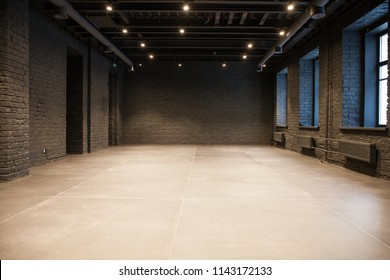 Empty room of black brick