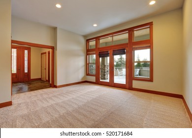Empty room with carpet floor and glass doors to large panoramic terrace. Northwest, USA