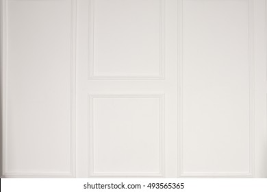 Empty room with classic white wood paneling on the walls  for use as an interior design or decor background