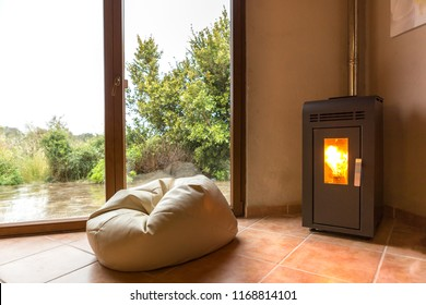 Empty room with a cozy corner and a flickering fireplace