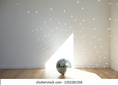 Empty Room with Disco Ball Sending reflections  All Over White Walls