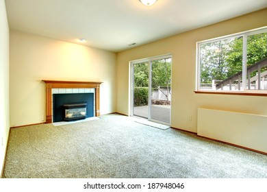 Empty room with fireplace and glass slide door to walkout deck