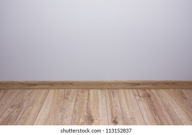 empty room with gray wall and wooden flor