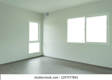 Empty room of a house with door and window.