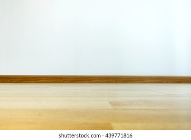 Empty room interior,parquet floor with white wall,house interior