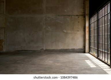Empty room with large windows and sunlight, Grungy room with light and shadow on floor, Concrete wall background