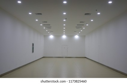 Empty room with lights at shopping mall. Architecture background.