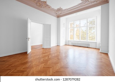 empty room, luxury apartment / flat in old building with wooden floor and stucco