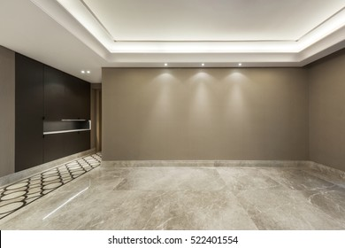 Empty room with marble flooring and beige wall paper decoration