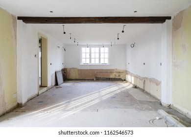 Empty room in an old house undergoing refurbishment, remodeling and redecoration, in preparation for a kitchen refit