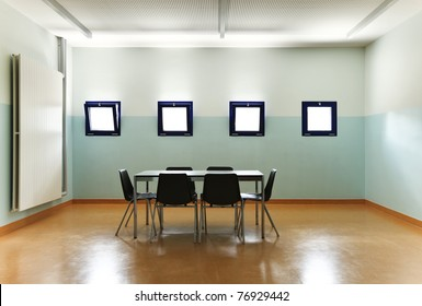 empty room with one table and chairs