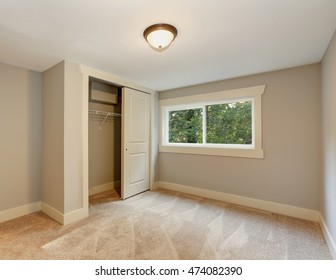 Empty room with soft beige carpet floor, window and closet. Northwest, USA