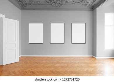 empty room with three blank picture frames hanging on wall in apartment