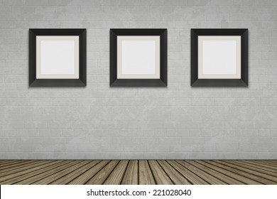 An empty room with three picture frames