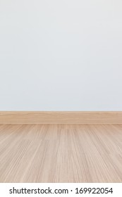 Empty room with wall and wooden floor laminate