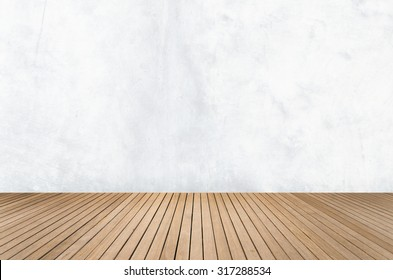 Empty room with white concrete wall and wooden floor