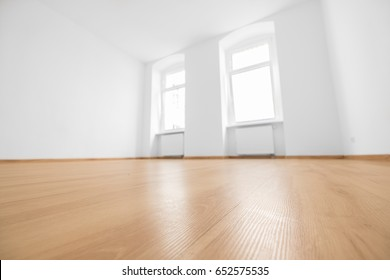 empty room, wooden floor in new apartment, blurred