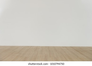 Empty room and wooden floor with white wall for background