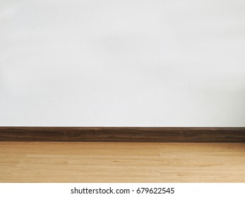 Empty room with wooden floor and white wall. Background with copyspace.