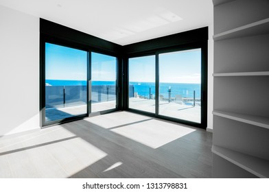 Empty rooms in a new house with large windows overlooking the sea. Automatic blinds. Glass partition terrace.