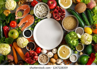 Empty round plate with set healthy and diet food (cereals, seeds, fish, vegetables and fruits). Healthy and diet menu of restaurant concept