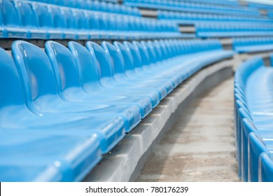 Empty rows with blue seats on a stadium