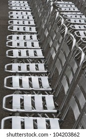 Empty Rows of metal chairs near the Town Hall in Vienna ready for concert.