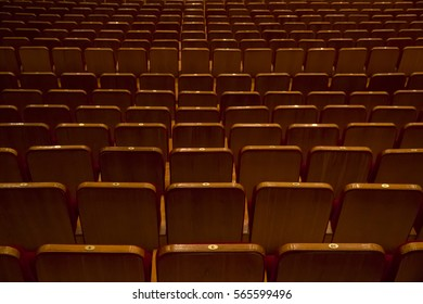 Empty rows of seats without people in cinema or concert hall view from back side