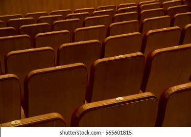 Empty rows of seats without people in cinema or concert hall view from back side.