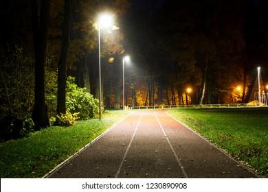 empty running track in small countryside stadium