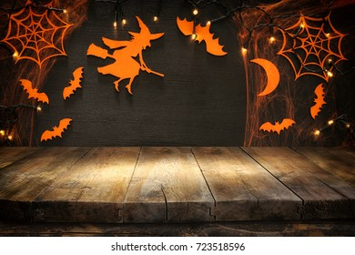 Empty rustic table in front of Halloween holiday background. Ready for product display montage.