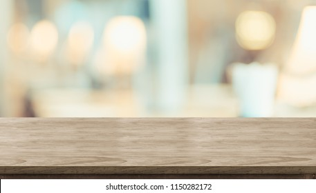 Empty rustic wood table and blurred soft light table in restaurant with bokeh background. product display template.Business presentation
