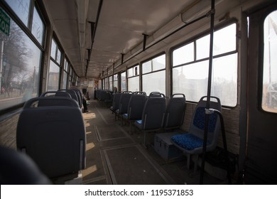 empty salon of public transport without passengers, tram, bus or trolley bus goes to the depot, leaves for the flight to the nearest bus stop, comfortable ride, pay for the ticket, a lot of free seats
