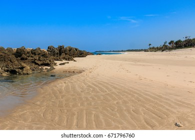Empty sand beach with clear blue sky off the Indian Ocean coast of Tanzania in the summertime